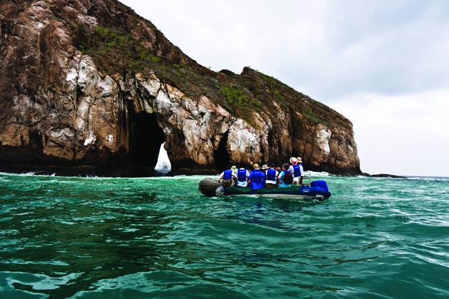 Ecoventura zodiac at Cerro Brujo, San Christobal in the Galapagos Islands,