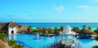 View from Sapphire Riviera Cancun overlooking the pool with views of the azure Caribbean Sea.