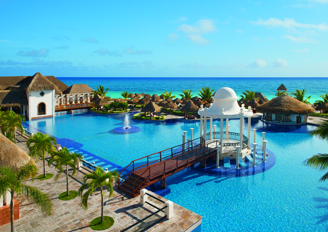 View from Sapphire Riviera Cancun overlooking the  pool with views of the Caribbean Sea.
