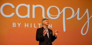 Christopher J. Nassetta, president and CEO of Hilton Worldwide, unveils the Canopy by Hilton new lifestyle hotel concept at Hilton Worldwide's Global Partnership Conference.