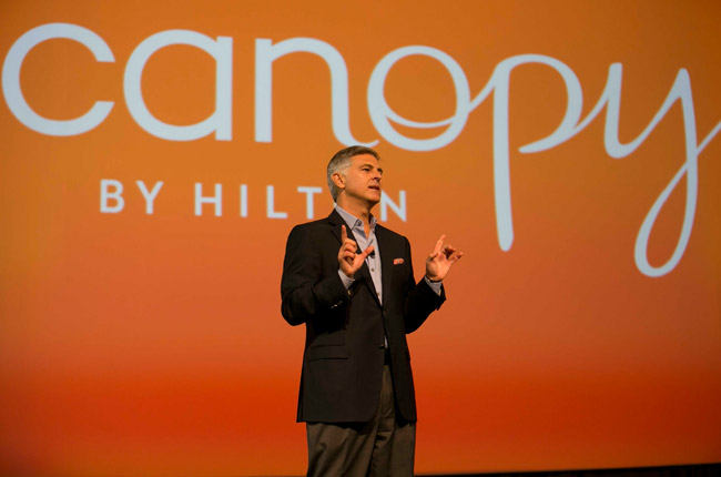 Christopher J. Nassetta, president and CEO of Hilton Worldwide, unveils Canopy by Hilton new lifestyle hotel concept at Hilton Worldwide's Global Partnership Conference.