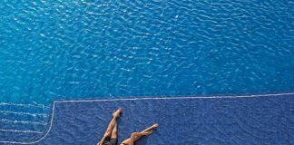 Couple enjoying a DREAMS resort pool.
