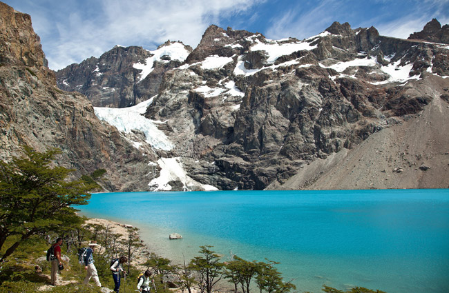 Hike through Laguna Azul with Quasar Expeditions' Patagonia Overland Safari.