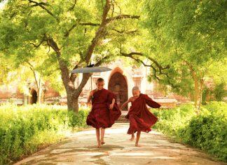 Two little monks running in Myanmar.