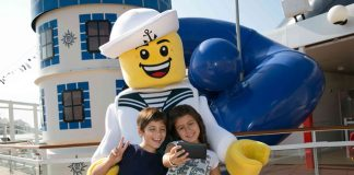 Guests interact with Sailor Walkabout part of the new LEGO collaboration aboard MSC Cruises.