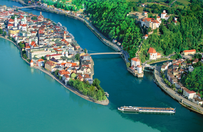 The AmaPrima cruising through the confluence of the Ilz, Danube and Inn rivers in Passau, Germany.