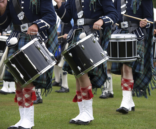 Guests can take in a Scottish pipe band while touring Scotland with Kensington Tours.