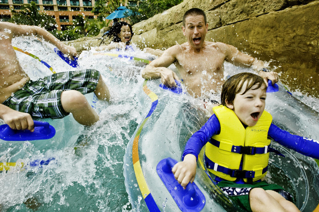 A family on The Current at Atlantis Paradise Island.