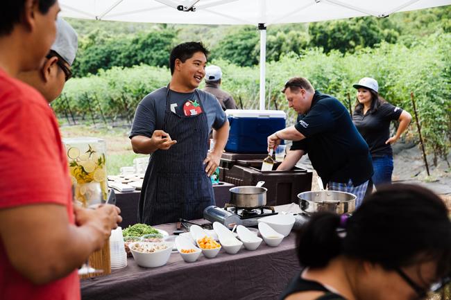 "Chef Colin Hazama cooking at Starwood Hawaii's ""Table to Farm"" dinner series. (Photo credit: Starwood Hotels & Resorts Hawaii.)"