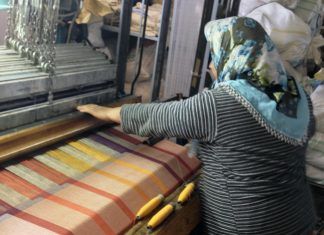 A weaver working on a Turkish towel.