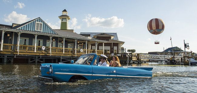 Guests go for a ride in a Captain-guided tour aboard an amphibious auto, known as an Amphicar, on Lake Buena Vista at Downtown Disney, as part of the waterfront adventures offered at The BOATHOUSE restaurant. The BOATHOUSE: Great Food, Waterfront Dining, Dream Boats, is a new upscale, waterfront dining experience in the heart of Downtown Disney with a gourmet menu featuring steaks, chops, fresh seafood and a raw bar. The BOATHOUSE from Schussler Creative is one of the new venues in The Landing, the first of four planned neighborhoods as Downtown Disney transitions to Disney Springs. Completion of Disney Springs is set for 2016. Downtown Disney is located at Walt Disney World Resort in Lake Buena Vista, Fla. (Matt Stroshane)