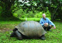 Writer Ed Wetschler poses with Galapagos' famous tortoises.
