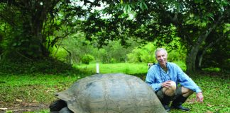 Writer Ed Wetschler poses with Galapagos' famous tortoises.