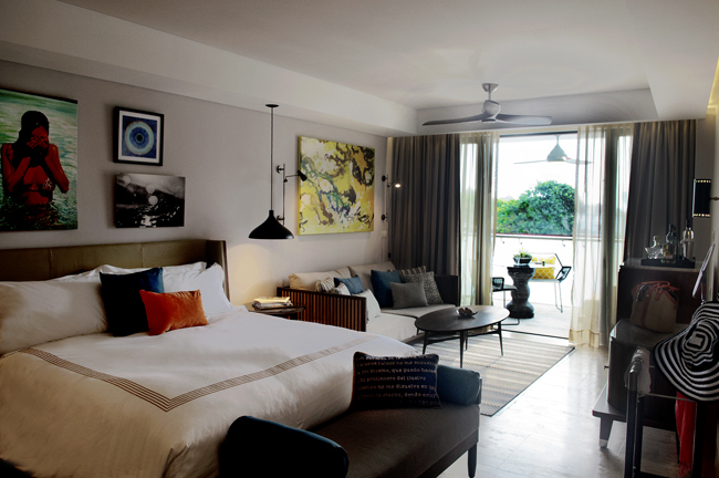 A guestroom with a terrace at Thompson Playa del Carmen.