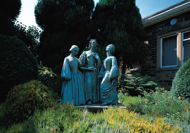A statue of Charlotte, Emily, and Anne Bronte outside of the Bronte Parsonage Museum in Haworth, West Yorkshire.