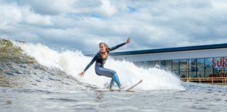 A surfer hangs 10 at Surf Snowdonia.