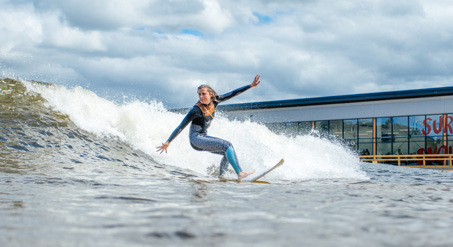 A surfer hangs 10 at Surf Snowdonia.