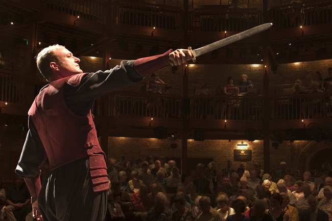 An actor with The Royal Shakespeare Company performs onstage at Stratford-upon-Avon theatre dedicated to the works of William Shakespeare.