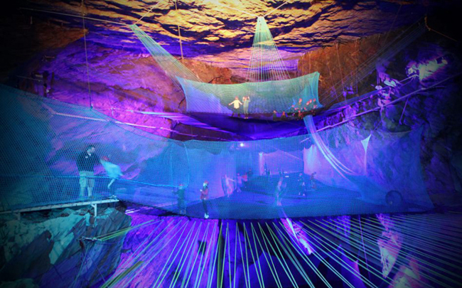 Guests bounce on underground trampolines at Bounce Below.