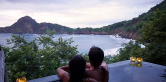 Guests relax in a jucuzzi while taking in the mountainous scenery in Nicaragua.