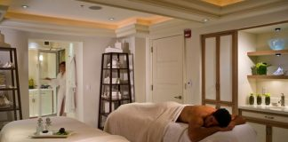 Guests can experience the Four Seasons Resort Palm Beach's East Coast Stone Massage during an adults-only getaway.