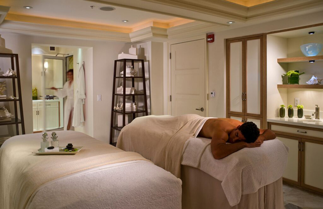 Guests can experience theFour Seasons Resort Palm Beach's East Coast Stone Massage during an adults-only getaway.