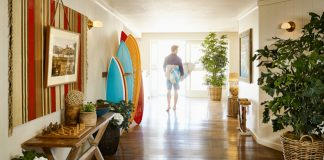 TheLaguna Beach House'sShape, Surf and Staypackage has guests shape their own custom surfboard to take out on the water.