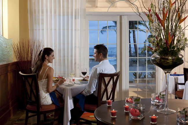 The Magdalena Grand Beach & Golf Resort's Romantic Honeymoon package features elegant touches such as a hotel suite decorated with rose petals.