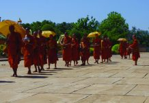 Monks file to prayer in Oudong, Cambodia. (Carla Hunt)
