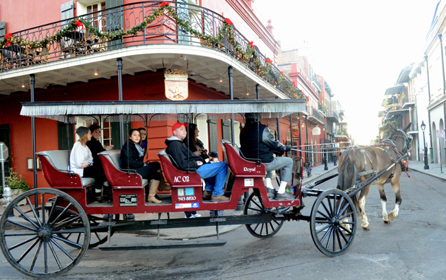 During theNew Orleans Convention & Visitors Bureau (NOCVB)'sChristmas New Orleans StyleFAM trip, agents can take advantageof a horse and carriage ride through New Orlean's French Quarter. (Photo credit:Jeff Anding)