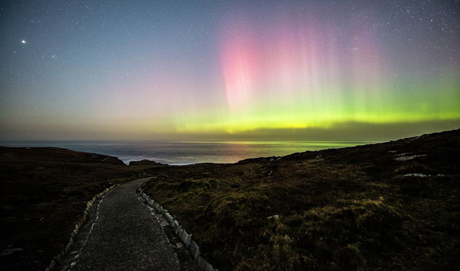 The Aurora Borealis in the night sky over Malin Head in County Donegal.