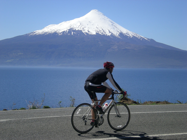 OnBicycle Adventures new 10-dayChile Lakes & Volcanoes, cyclists ride past theAndes Mountains in Chile.