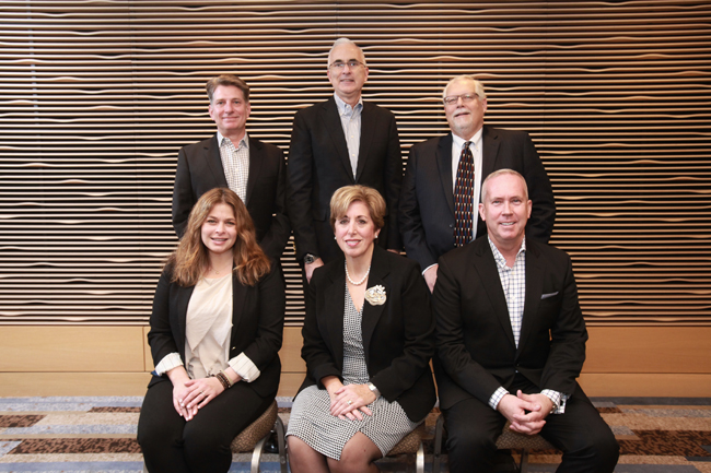 The 2016 USTOA Executive Committee, with Paula Twidale seated center. The other committee members are from seated left, Dana Santucci, Jerre Fuqua, Charlie Ball and Terry Dale.