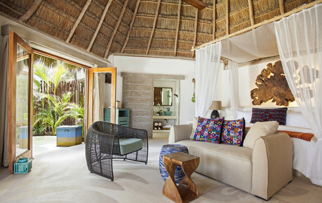 The Mahekal Beach Resort's Deluxe Oceanfront King palapa-style bungalow.