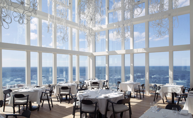 Fogo Island Inn's glass-fronted dining room in Canada.
