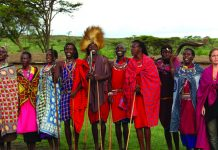 A Maasai community welcome is warm and colorful. (Carla Hunt)