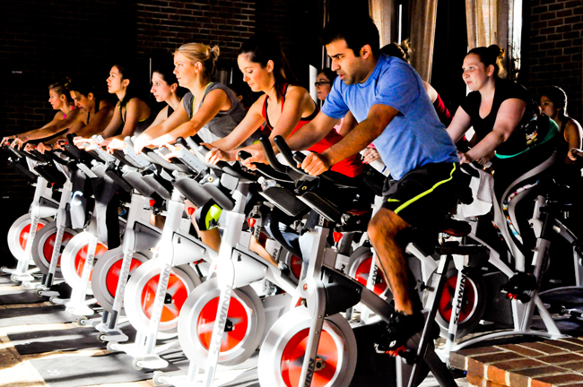 The Refinery Hotel's new wellness program includes pop-up fitness classes such as cycling.