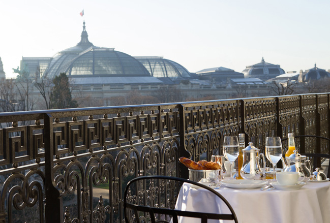 At La Reserve Paris, couples can meals on the property's rooftop overlooking the Grand Palais museum.
