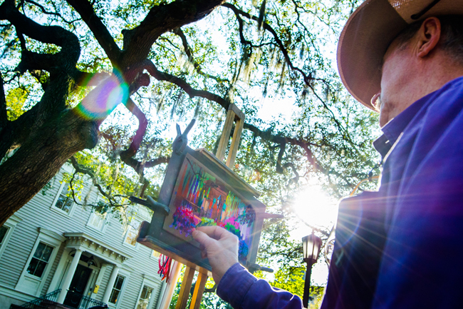 An artist painting in Chippewa Square. (Photo credit: Visit Savannah)