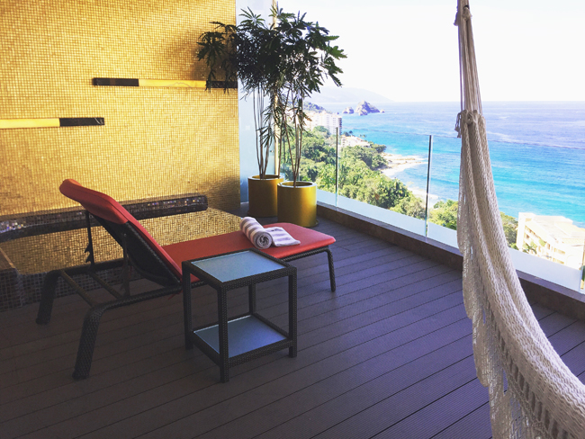 The balcony at Hotel Mousai, complete with a Jacuzzi and a hammock.