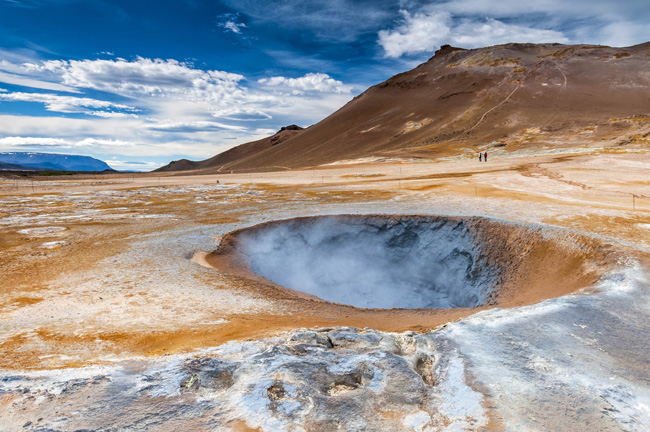 Boiling mudpot in the Hverarond geothermal field in Iceland.