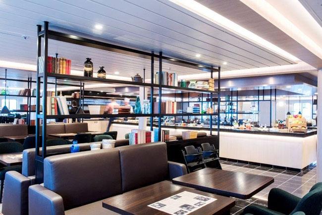 The dining room on Hurtigruten's refurbishedMS Polarlys vessel featuremodern Scandinavian design elements.