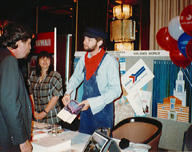Paul Wiseman, president at Trafalgar and Brendan Vacations USA, working at a trade show during his days as an agent.