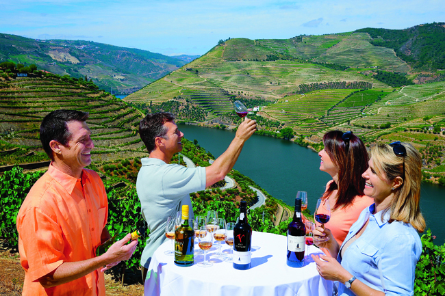 Guests enjoying a wine tasting on AMAwaterways' shore excursion at Sandeman Winery in the Douro Valley.