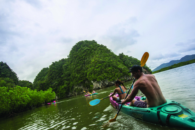 Travelers kayaking in Thailand with G Adventures. (Photo credit: G Adventures.)