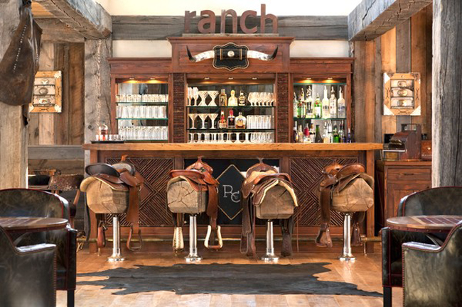 The Silver Dollar Saloon is an evening entertainment hub at The Ranch at Rock Creek in Montana that is equal parts cowboy saloon and luxe club.