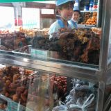 Our guide Michael choosing snacks for us to sample while touring Beijing.