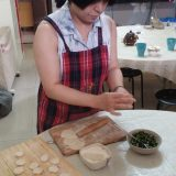 A local resident in one of Beijing's Hutong neighborhoods showing us the art of making dumplings in her home.