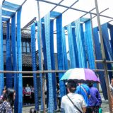 Blue silk drying the old-fashioned way in the ancient water town of Wuzhen.