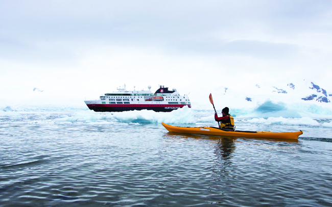 Kayaking in Antarctica is one of the many thrills for guests when sailing with Hurtigruten.